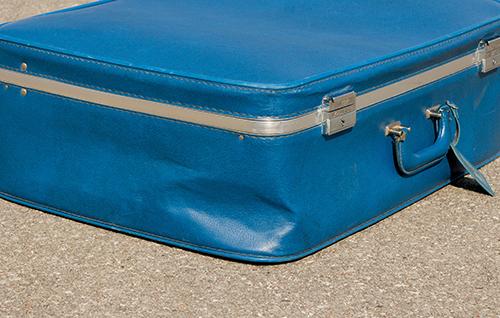スーツケースのボディ凹み修理